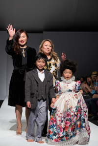 Designer Nancy Wuu (left) with her two children and sister, Catherine Wuu (right) after showing LA SFW 2014