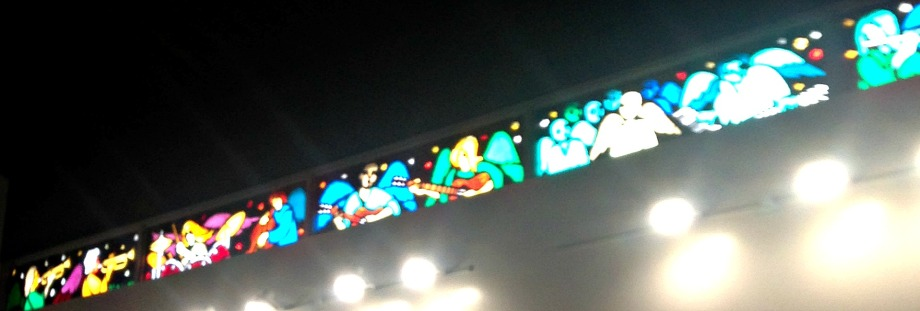 The math of music! Do you see the balanced triangles in this rock band? Stained glass window of angels playing instruments.