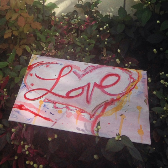 Love painting with garnet and gold acrylic on canvas and hearts.